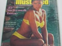 Four old Sports Illustrated swimwear publications