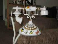 Designer old style cradle phone and collectibles lamp.