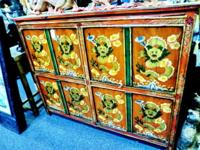 This is an original dragon painted cabinet from Tibet,