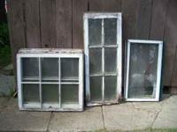 20 various sized wood frame windows. A couple with