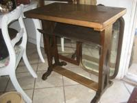 This is a sturdy solid wood table with a magazine type