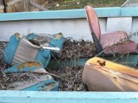 Old boat and trailer could be fixed up or thrown away.