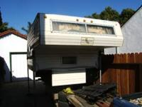 priced to sell as is 8'cab over camper in decent shape