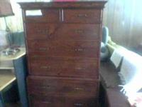 Older antique style chest has separate base and upper