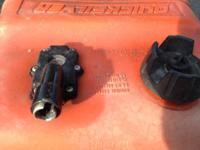 older fuel cans, one metal omc the other plastic and I