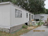 Double wide mobile home is yours free to remove for