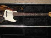 This is a used and modified Fender jazz bass. It play