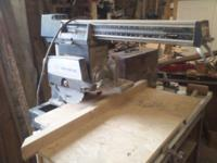 "Older Wards 10"" Radial Arm Saw out of small wood shop."
