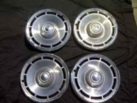 THIS IS A SET OF CHEVY HUBCAPS IN GREAT CONDITION CALL