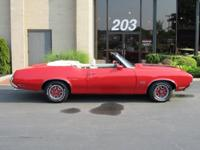 Matador Red with Black hood stripes, White interior,