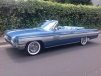 1962 Oldsmobile Starfire Convertible painted in Pacific