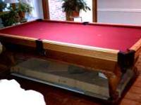 "Olhausen Pool table. Measures 103"" L x 57""W x 32"" H."