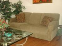 Comfortable sofa, olive green, fabric. Here you can see