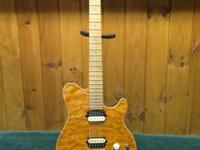 This OLP by Music Man MM1 Electric Guitar is in