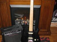Black OLP MM1 guitar, Zebra pick ups, silver metal