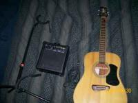 We are selling an Olympia Acoustic Electri Guitar Model