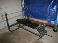Olympic bench with leg developer. the leg attachment