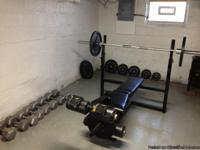 Olympic sized bench, bar (with clips), weights (4-45lb