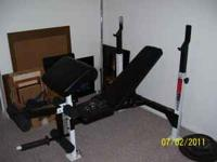 210lbs. olympic weights, weider mid range bench will