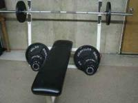 here i have a next to new olympic weight set with 375