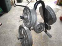 Olympic weights with bar 300 lb.; (2 45's, 2 25's, 2