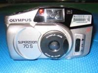 I have an Olympus 35 mm and 2 carrying cases with some