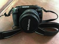 An Olympus Evolt 330 Digital SLR Camera Body and a