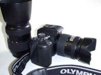Includes: E-500 Body, Body Cap, Olympus 14-45mm,