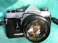 Here is a good working Olympus OM1 35 mm camera with