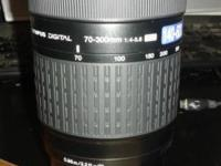 This is a used lense in excellent condition. Takes