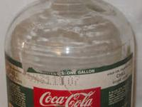 Up for consideration is a vintage one gallon Coca Cola