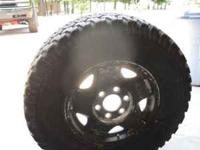 I have one BFGoodrich A/T Tire about half tread on a