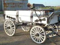 Very nice horse drawn wagon. Wood wheels are solid with