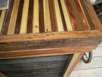 Custom built from barn wood as a kitchen island - or