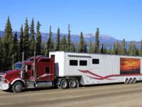 One of a kind 53 foot toy hauler behind a Kenworth