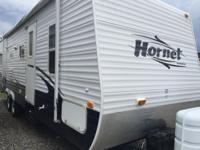 One owner trailer with living room and bunk slide. Lots