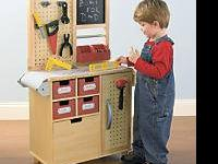 Tool bench is made of real wood. Super sturdy! its from