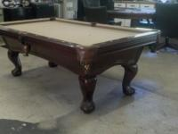 This is a beautiful one piece slate pool table that