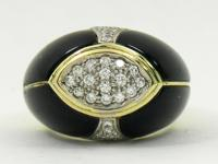 This tailored, 14K yellow gold onyx and diamond dome
