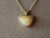 Beautiful 14k slider pendant holding a free form bezel
