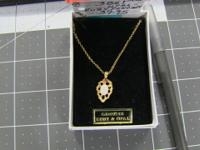 "Opal and ruby 17"" pendant with gold leaf tone, valued"