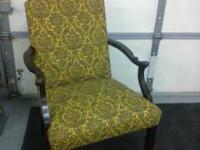 This chair has just been reupholstered In a yellow and