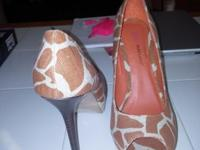 These are Orange Giraffe Print Woman's Shoes Size 11