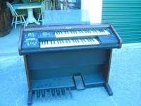Keyboard style Organ...with bench.The brand is