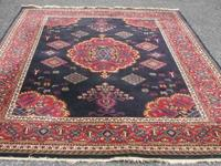 This Oriental carpet is 100% wool. It is machine made.