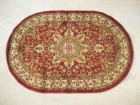 Oriental Design Oval Rug by Dynamix. Bright red. A