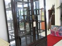 Beautiful curio in dark wood with glass shelves and