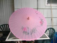 This umbrella is beautiful it is made of wood and
