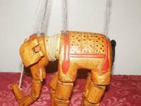 This is an antique jointed wood toy elephant puppet