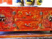 This old painted Chinese low cabinet is in great shape